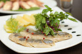 Herring appetizer - fillet with vegetables — Stock Photo