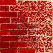 Vintage background - red brick wall and floral pattern — Stock Photo