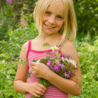 Smiling Girl with Flowers Outdoor — Stock Photo