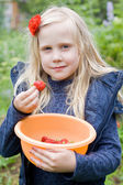 Beautiful Girl with Red Strawberry in Garden — Stock Photo