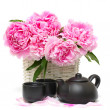 Stock Photo: Chinese tea set and pink peony flower isolated on white