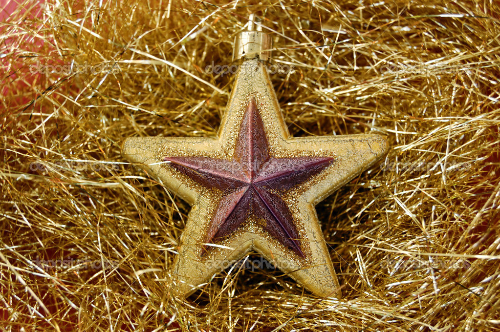 Christmas star bauble on golden background. Seasonal decoration. — Stock Photo #5399261
