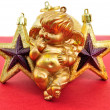 Angel and golden christmas stars — Stockfoto