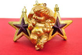 Angel and golden christmas stars — Stock Photo