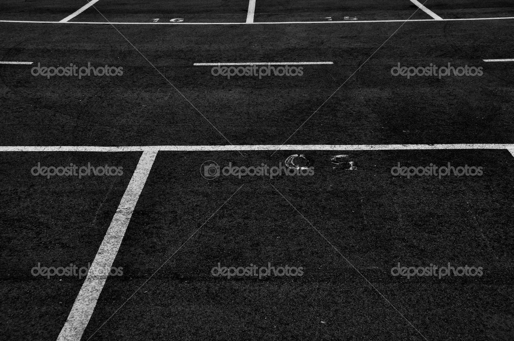 Dividing lines in empty parking lot abstract background. Black and white. — Stock Photo #5425190