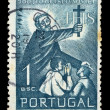 Priest with cross postage stamp - Foto Stock