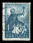 Priest with cross postage stamp — Stock Photo