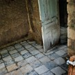 Decayed room interior with tiled floor — Stock Photo