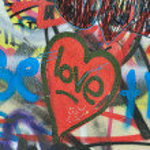 Dirty love graffiti urban background — Stock Photo #6153066