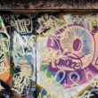Stock Photo: Grunge urban wall with messy graffiti tags