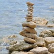 Stone structure on rocky shore — Stock Photo