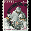 Surgeons performing surgery vintage postage stamp — Stock Photo