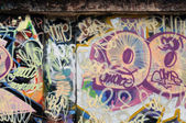 Grunge urban wall with messy graffiti tags — Stock Photo
