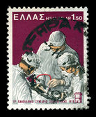 Surgeons performing surgery vintage postage stamp — Photo