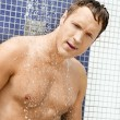 Man under the shower — Stock Photo