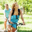 Young happy couple riding a bicycle — Stockfoto
