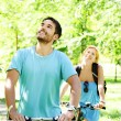 Young happy couple riding a bicycle — Stock Photo