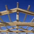 Wooden roof during the early stages of construction — Stock Photo #5818351