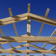 Wooden roof during the early stages of construction - Stock Photo