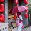 Woman in lijiang — Stock Photo