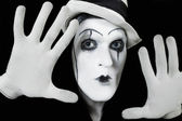 Face and hands of mime with dark make-up — Stock Photo