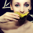 Beautiful young woman with pear — Stok fotoğraf
