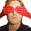 Male face with red hands — Stock Photo