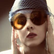 Young woman in a retro sunglasses — Stock Photo #5973385
