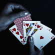 Metal men's hands with playing cards — Stock Photo