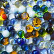 Stock Photo: Background with transparent colored glass beads
