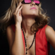 Young blonde woman in pink glasses — Stock Photo