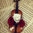 Old violin with musical notes and roses — Stock Photo #6310410