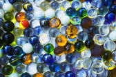 Background with transparent colored glass beads — Stock Photo