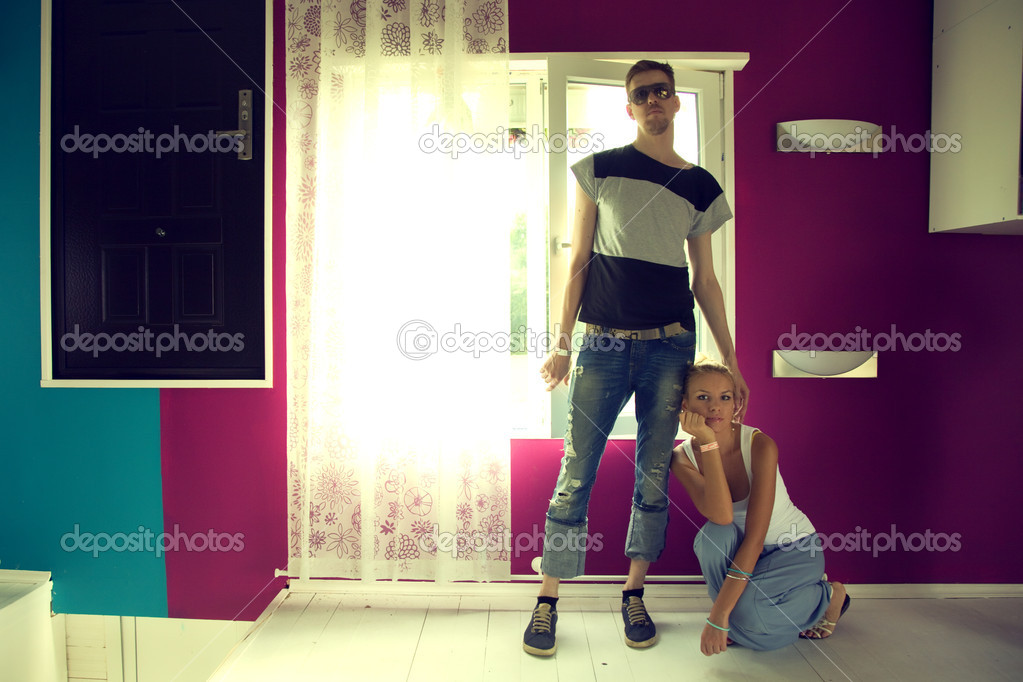 Young man and woman in a purple room — Stock Photo #6381419
