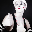 Mime in makeup and  white hat - Stock Photo