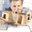 Architect with model house — Stock Photo #5825862