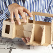 Architect with model house — Stock Photo