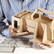 Stock Photo: Architect with model house