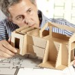 Architect with model house — Stock Photo #5825883
