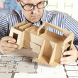 Architect with model house — Stock Photo #5825902