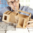 Architect with model house — Stock Photo #5825907