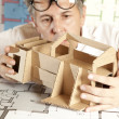 Architect with model house — Stock Photo #5825926