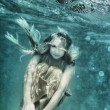 Woman underwater — Stock fotografie