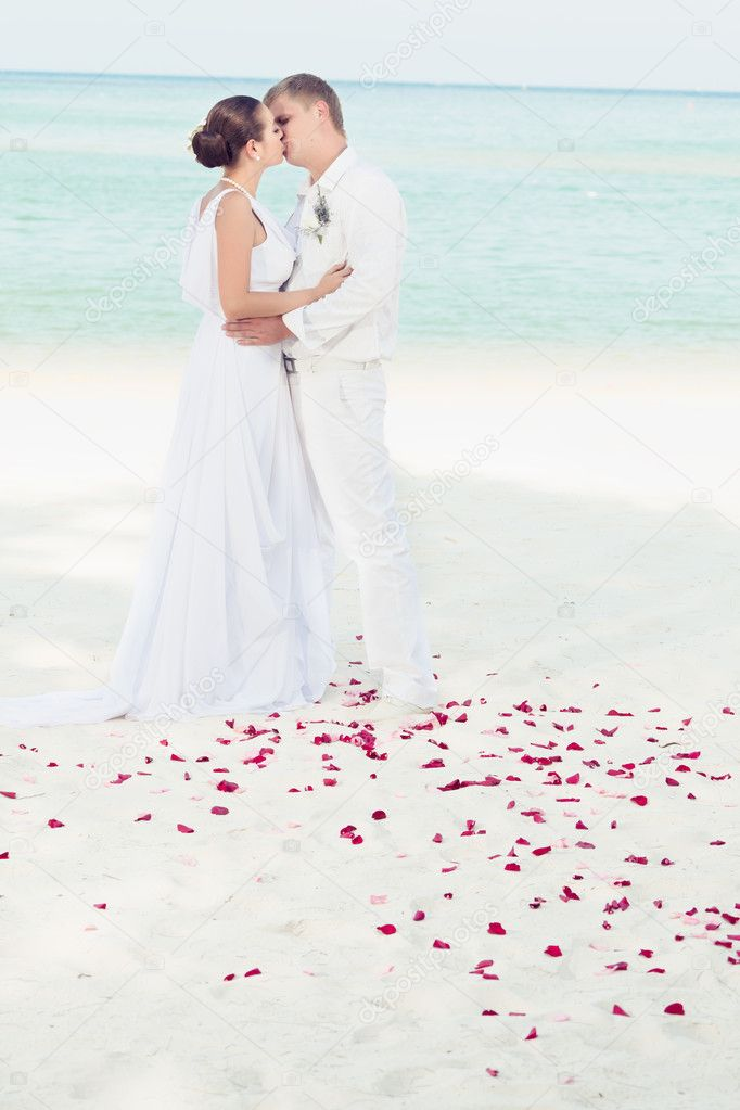 Bbride and groom kissing on the tropical beach  Stock Photo #5528580