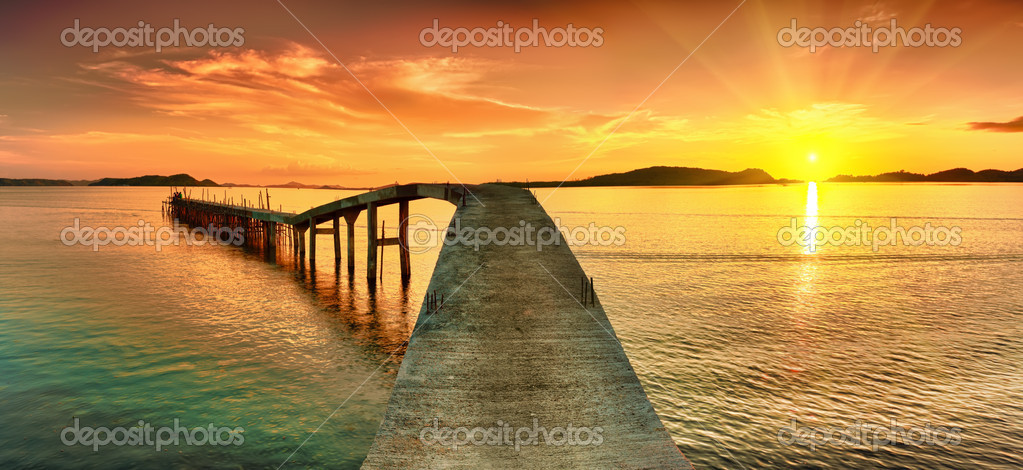 Sunrise over the sea. Pier on the foreground. Panorama — Stock Photo #5703189