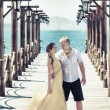 Couple on pier - Stock Photo