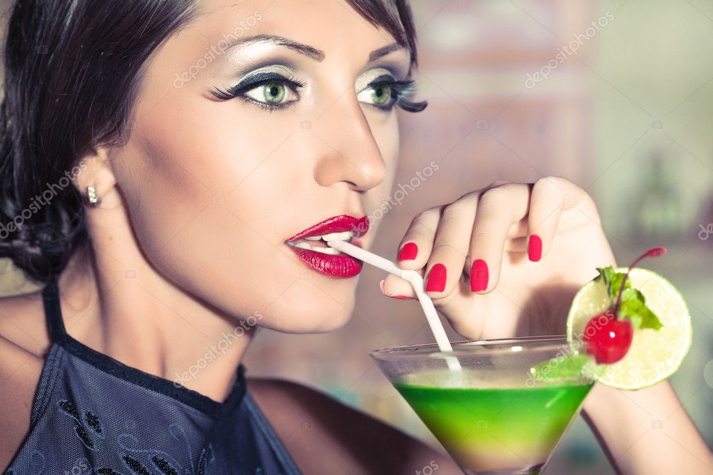 Fashion woman retro portrait with a cocktail  Stock Photo #6425288