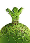 Symbolic tree man on the planet — Stock Photo