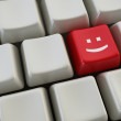 Keyboard with smile button — Stock Photo