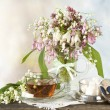 Stock Photo: Tein cup and lilies of valley